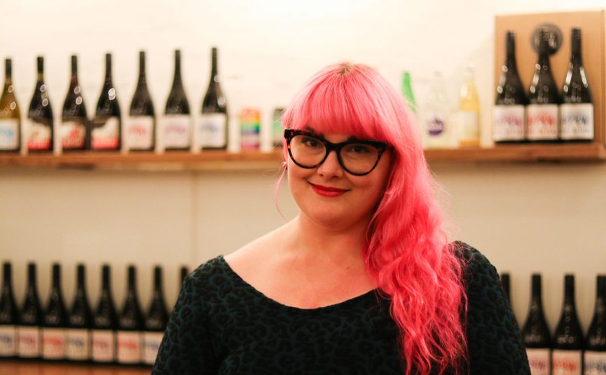 woman with pink hair and glasses