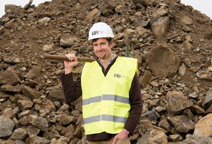 man holding pickaxe