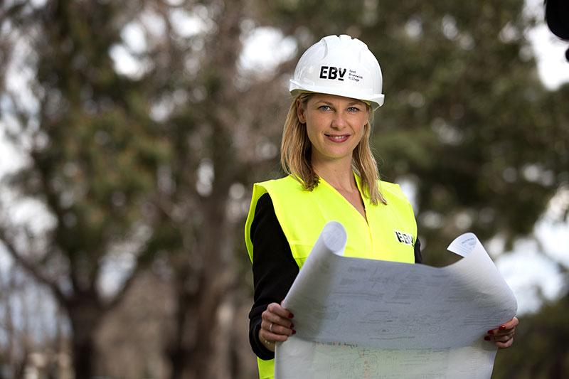 woman holding building plans