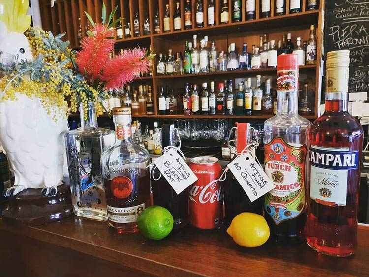 Atticus Finch bar with a selection of liquers on the bench