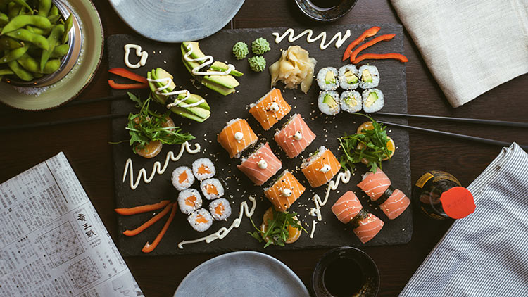 an array of sushi platter selections spread out on the table