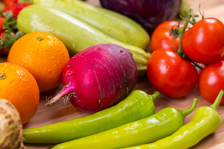 a group of vegetables packed together on a chopping board